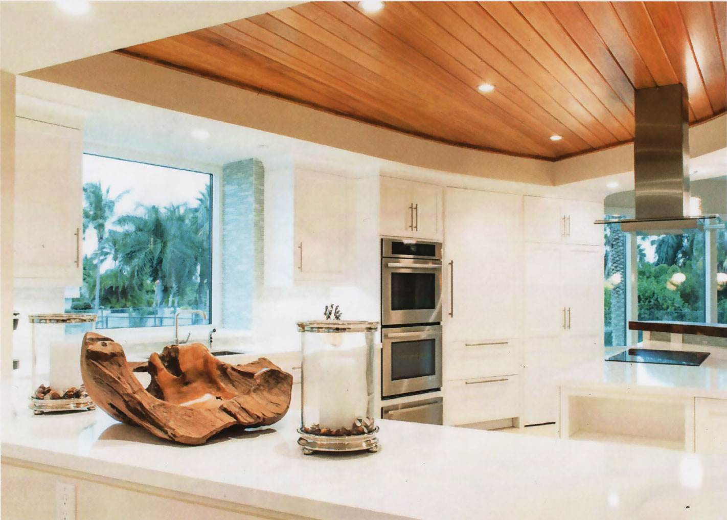 Custom made wood ceiling tray in coastal inspired all white kitchen with marble countertops