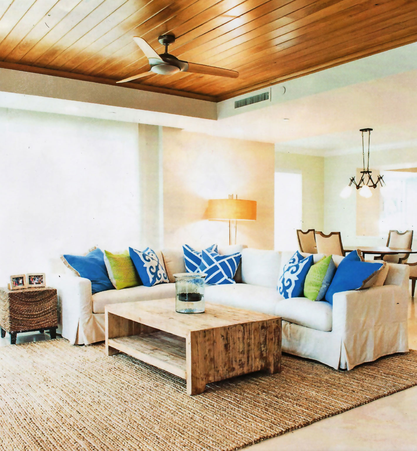 Comfortable coastal inspired living area with custom wood ceiling and urban style furniture.